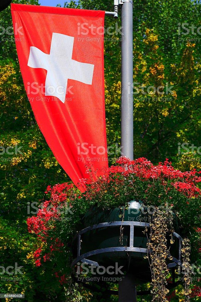 Swiss flag, Colorful Bright flowers garden foliage, Interlaken, Switzerland stock photo