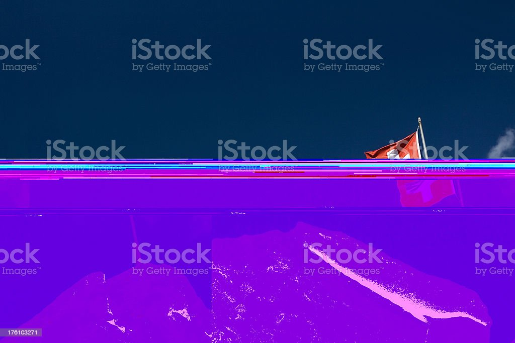 Swiss flag on the mountain stock photo