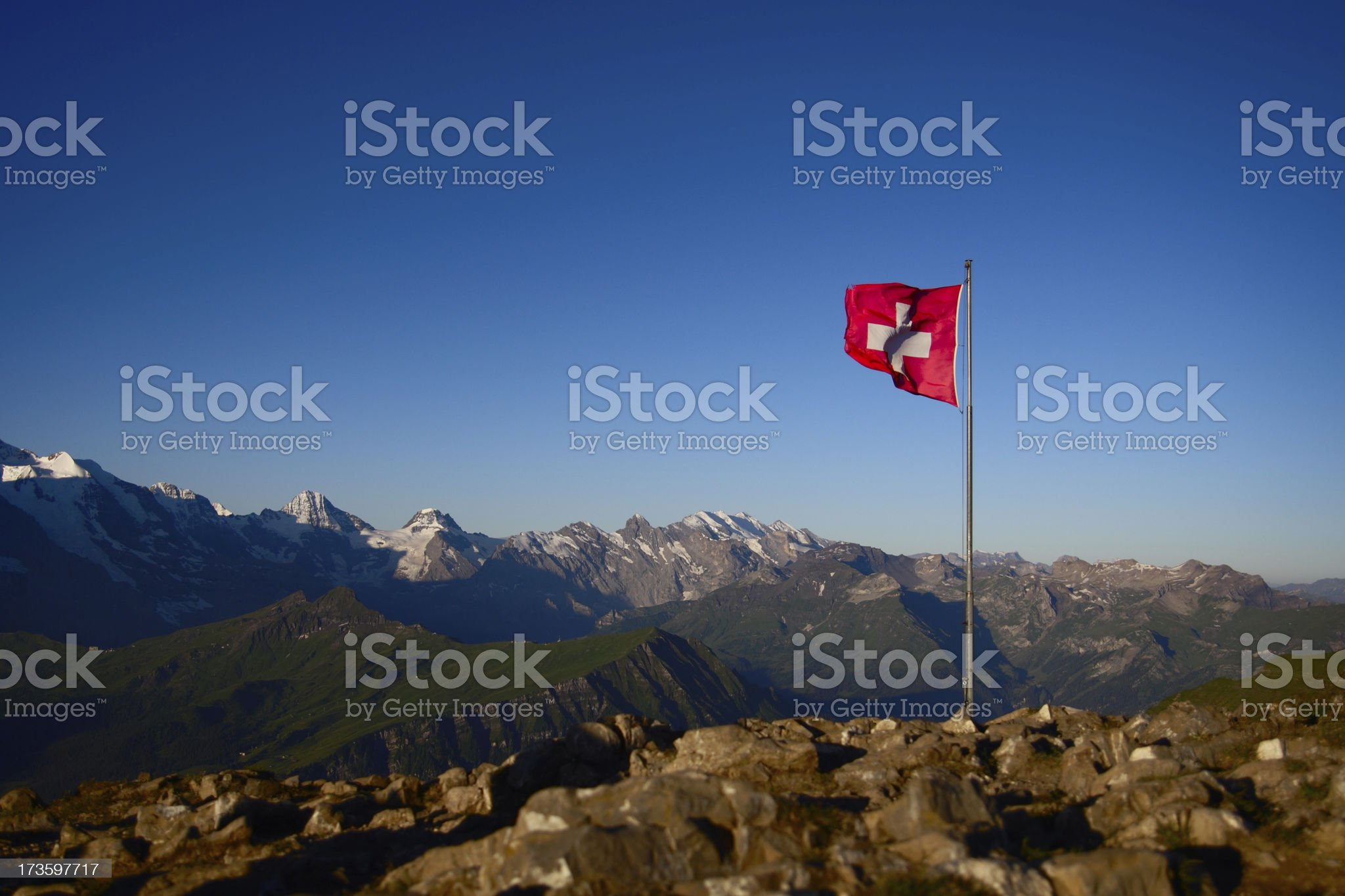 Swiss Flag on Top of a Mountain royalty-free stock photo