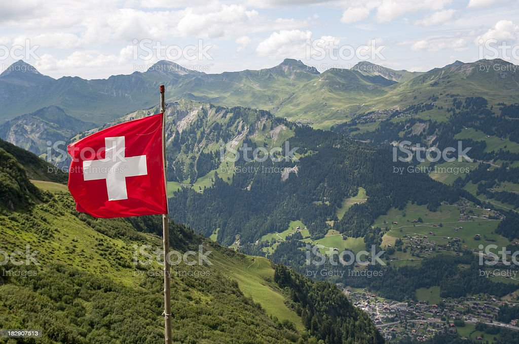 Swiss flag over Alps royalty-free stock photo