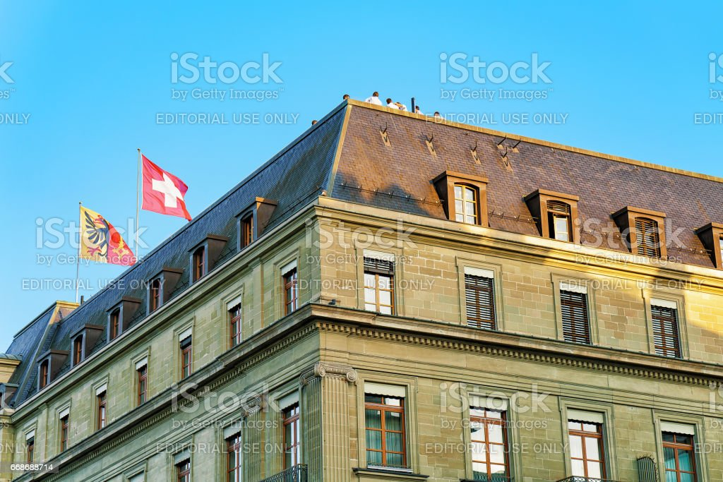 Swiss flags on top of building in Geneva stock photo