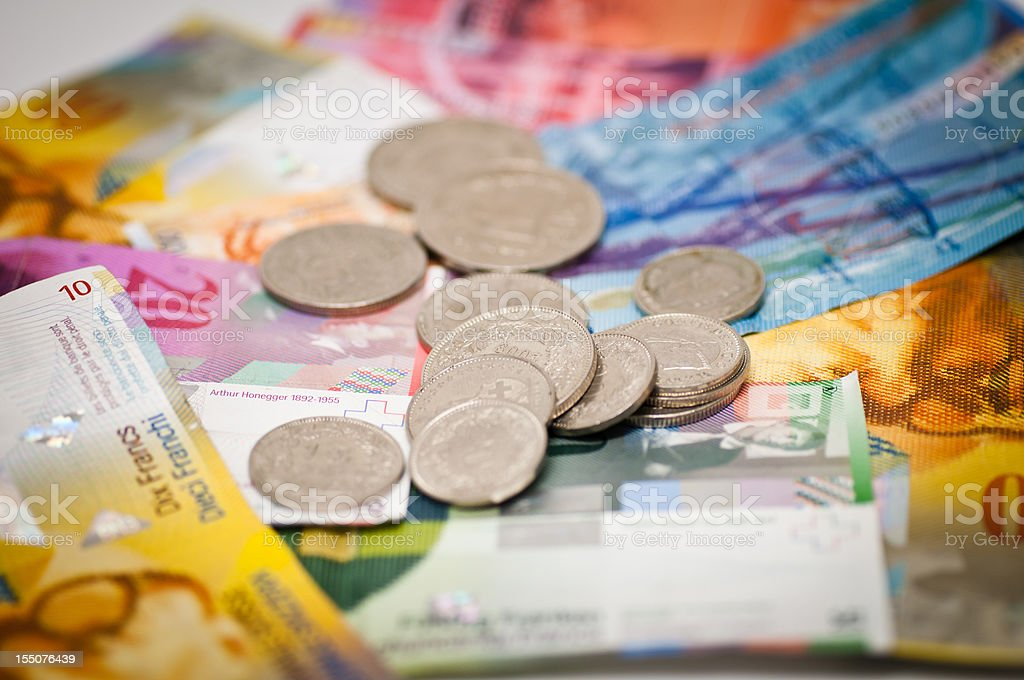 swiss franc currency stock photo