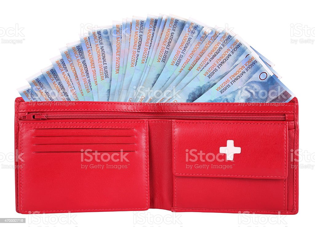 Swiss francs in red wallet stock photo