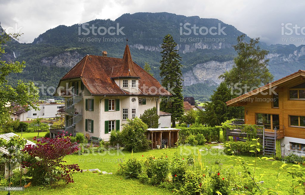 Swiss houses with a garden stock photo
