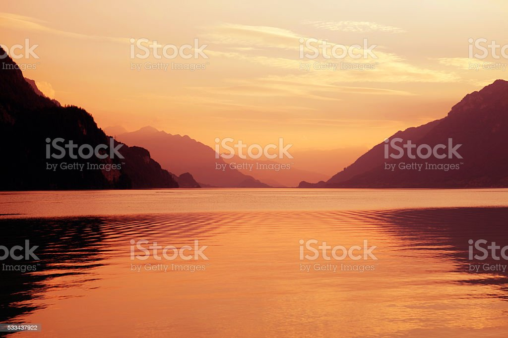 swiss lake sunset stock photo