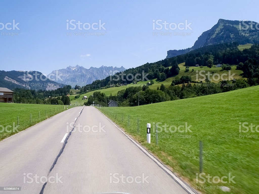 Swiss landscape, mountains and green meadows stock photo