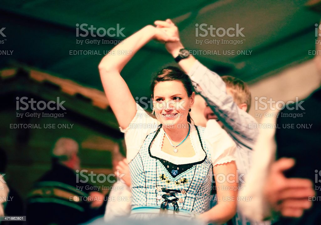 Swiss maiden dancing at agricultural fair royalty-free stock photo