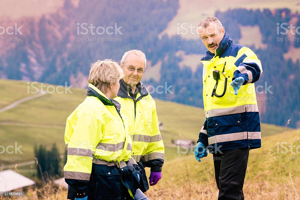 Swiss medic rescue team discussing approach royalty-free stock photo