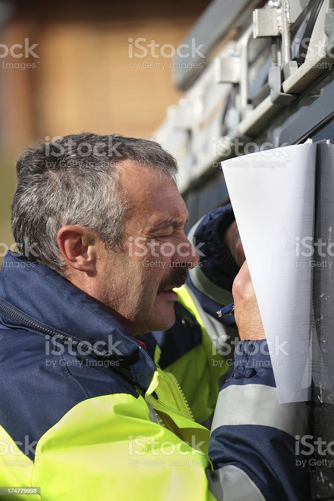 swiss mountain rescue paramedic completes paperwork stock photo