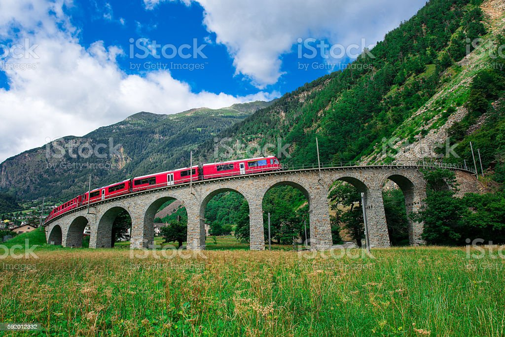 Swiss mountain train Bernina Express Cross the bridge stock photo