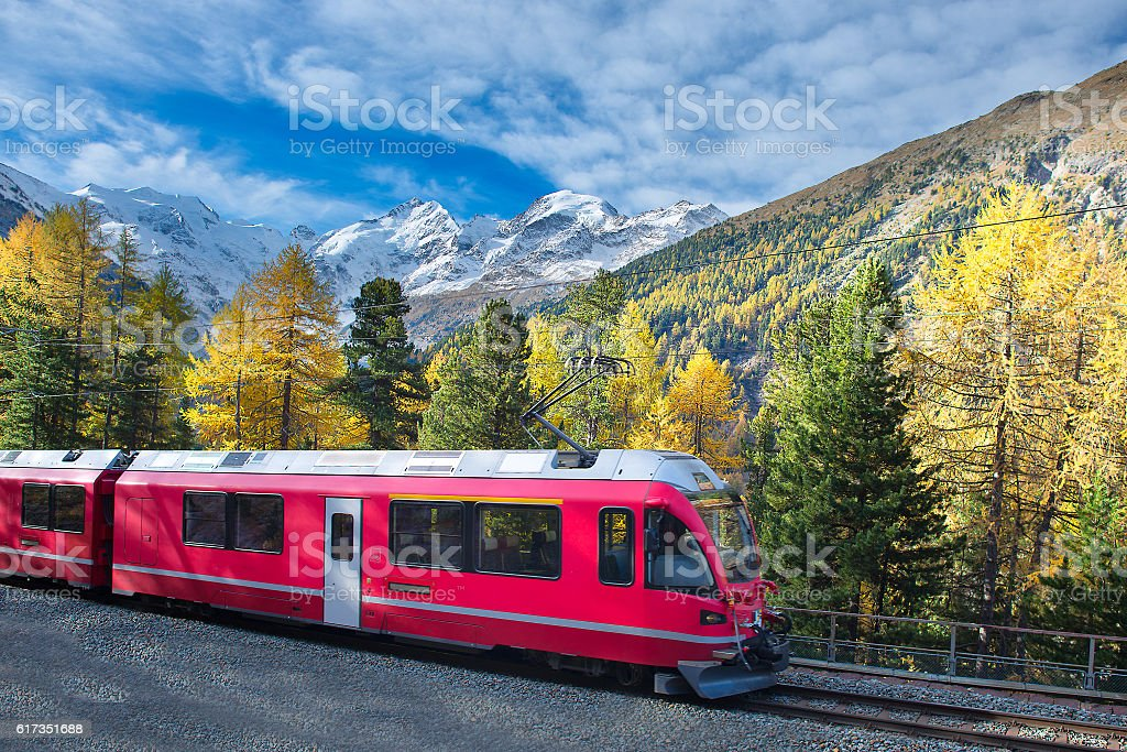 Swiss mountain train Bernina Express crossed Alps in autumn stock photo