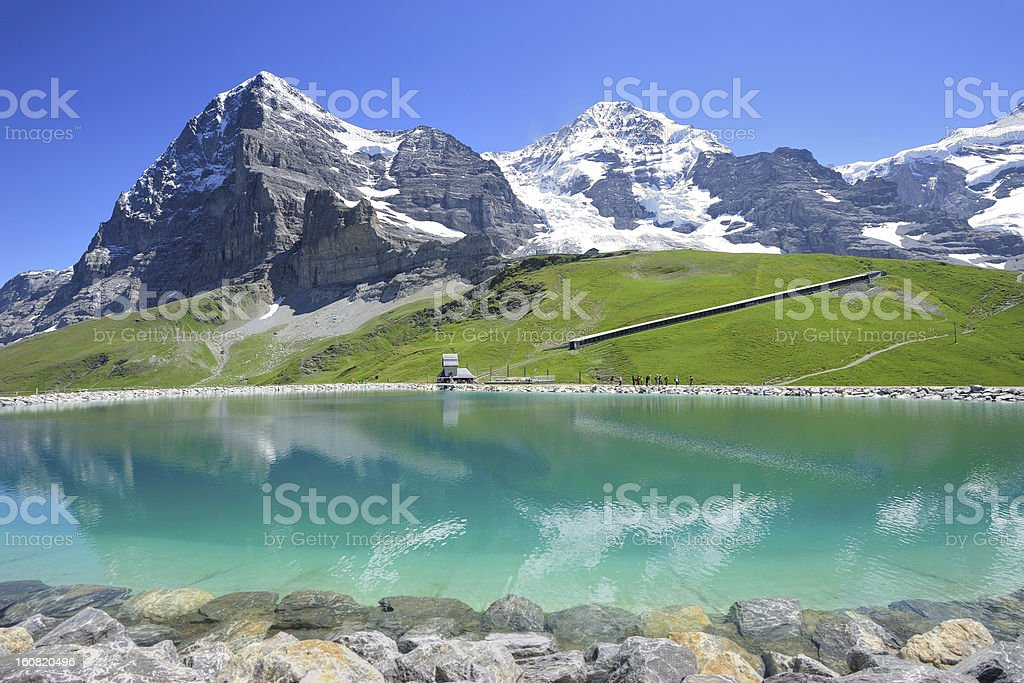 Swiss Mountains at Bernese Alps Reflecting in Reservoir stock photo