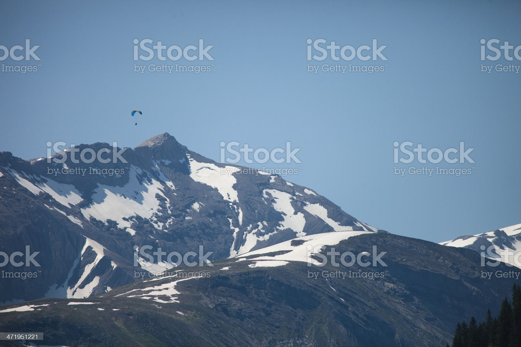 Swiss paraglider high in the Alps, mountain peaks royalty-free stock photo