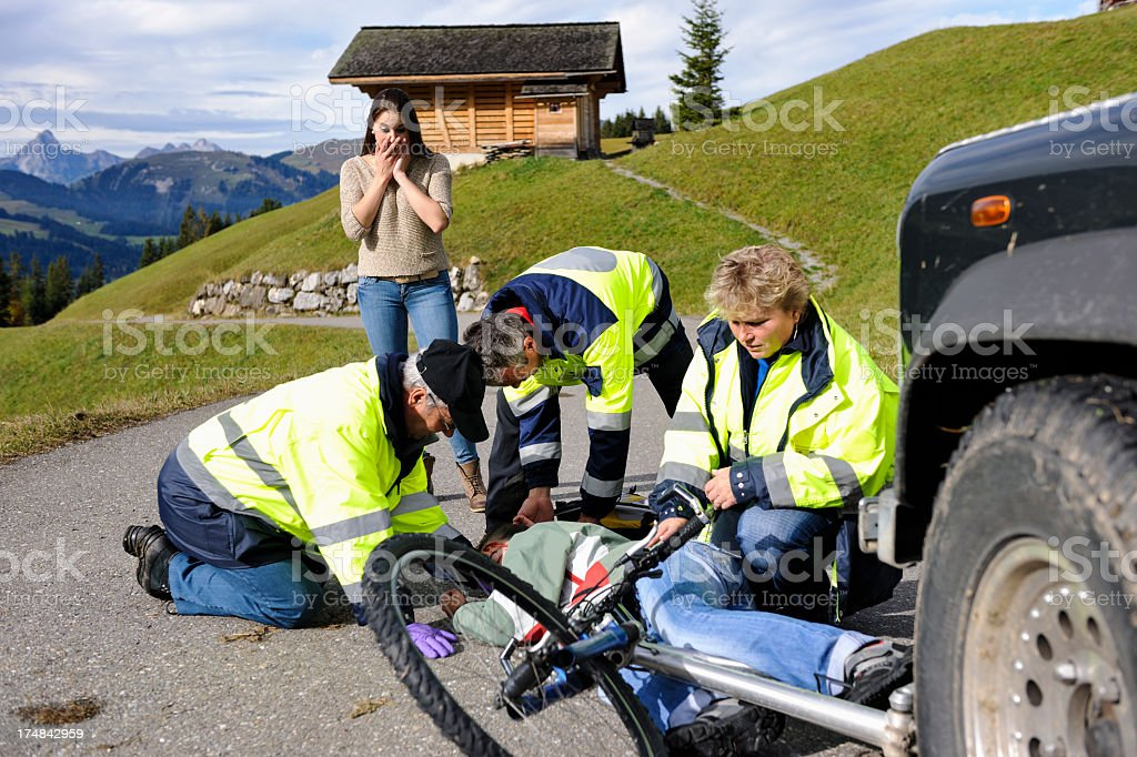 Swiss paramedics helping with a biking accident stock photo