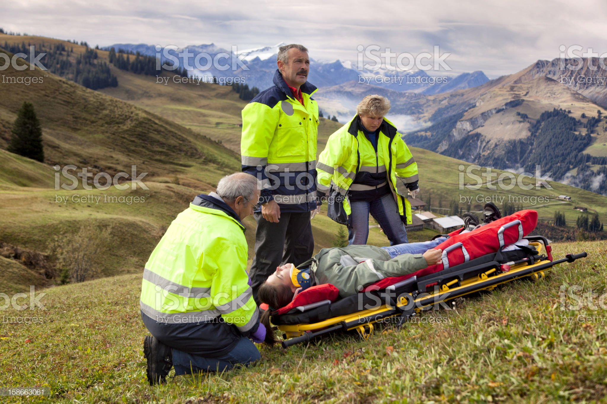 Swiss Paramedics Team Care For Injured Woman in Alps royalty-free stock photo