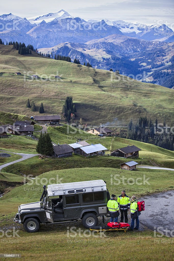 Swiss Paramedics Team With Jeep in Alps royalty-free stock photo