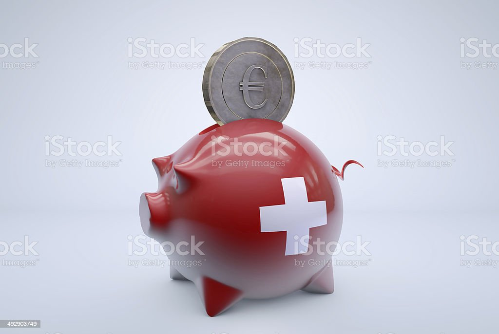 Swiss piggy bank with euro coin stock photo