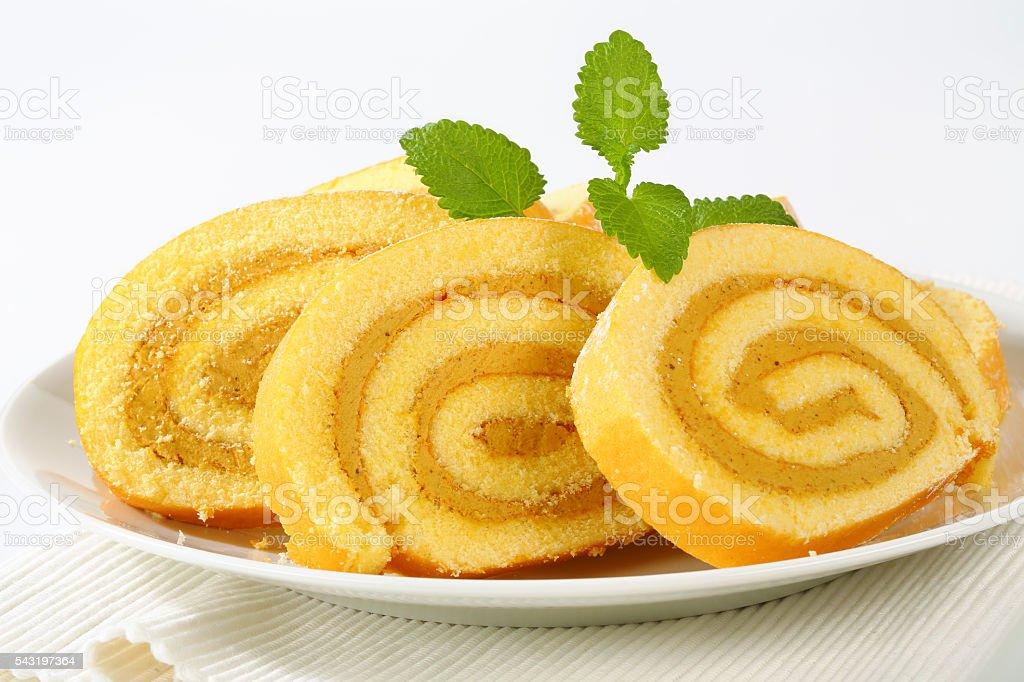 Swiss roll peanut butter cream sponge cake roulade stock photo