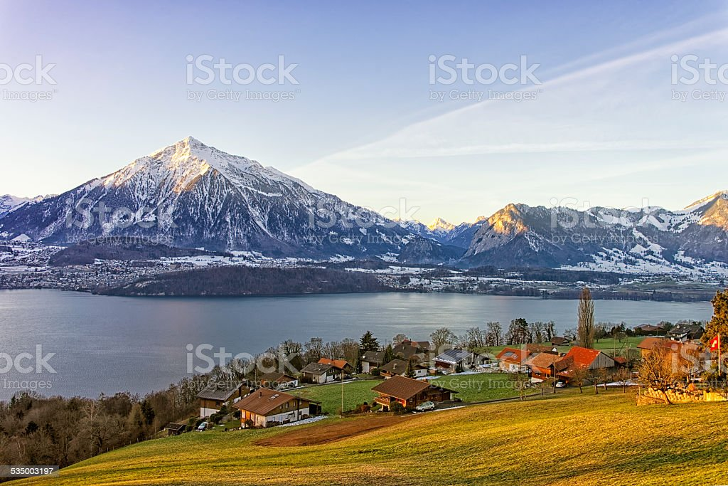 Swiss rural landscape near Thun lake at morning sunshine stock photo