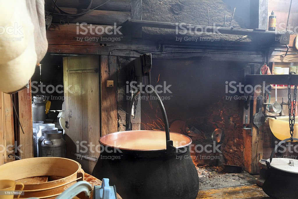 swiss traditional cheesemakers cottage with cauldron and open fire royalty-free stock photo