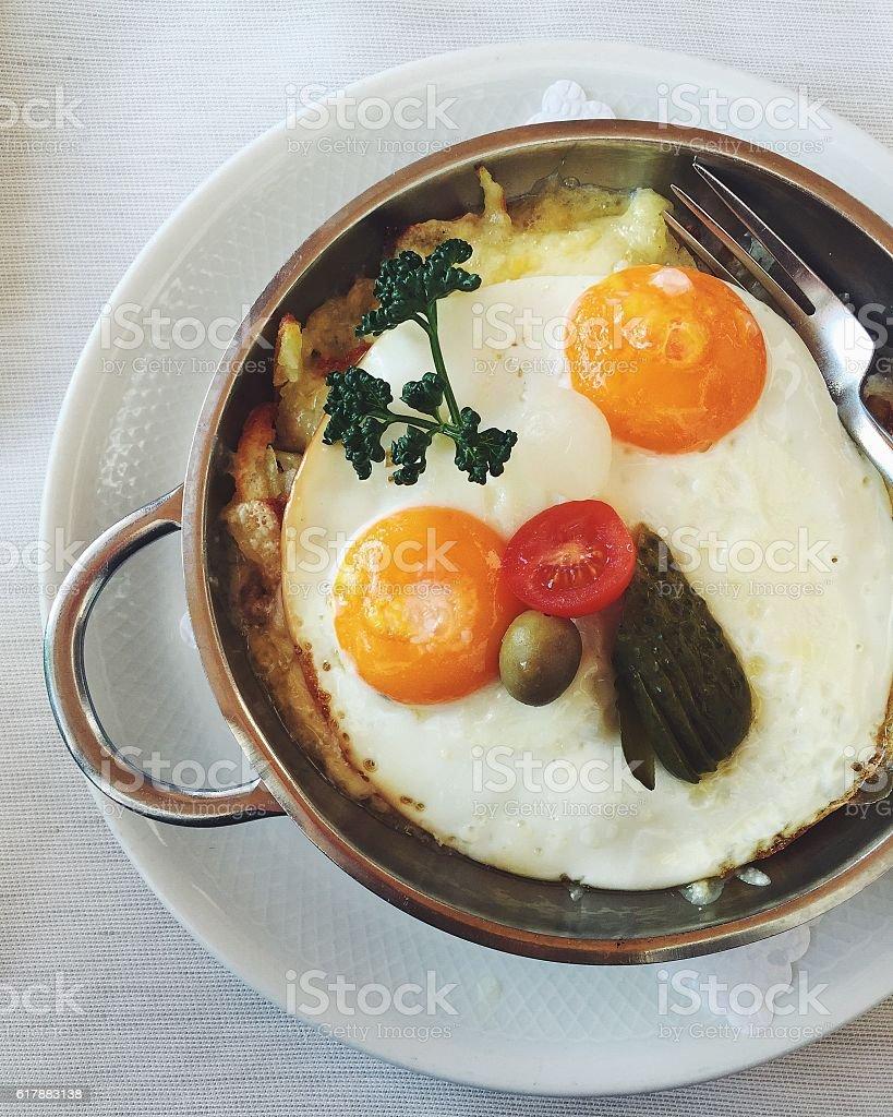 Swiss vegetarian potato rösti with sunny side up fried eggs stock photo
