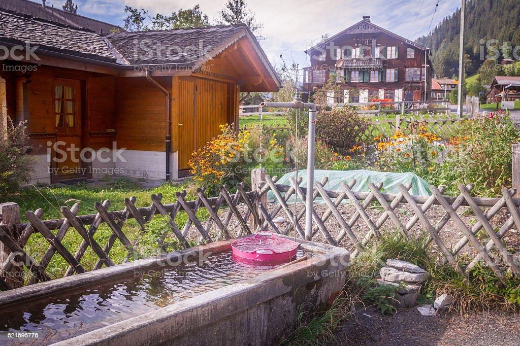 Swiss Village water trough stock photo