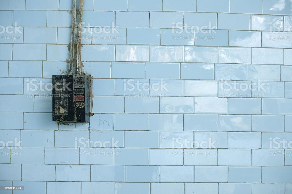 switch on blue wall stock photo
