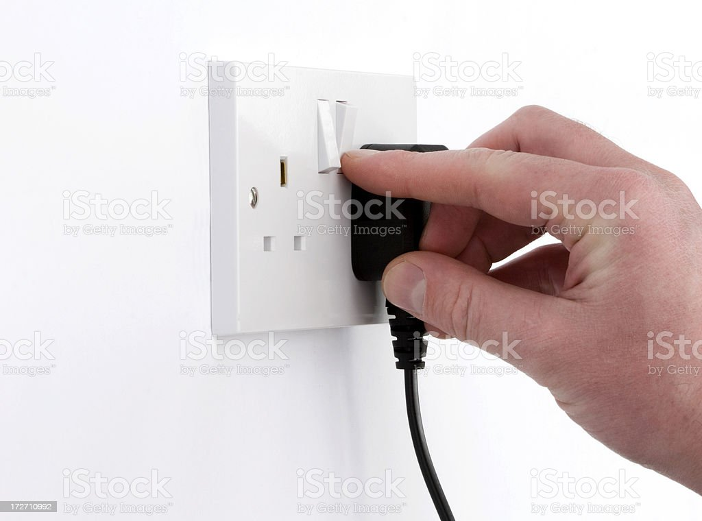 Switch On power with British plug and electricity socket royalty-free stock photo