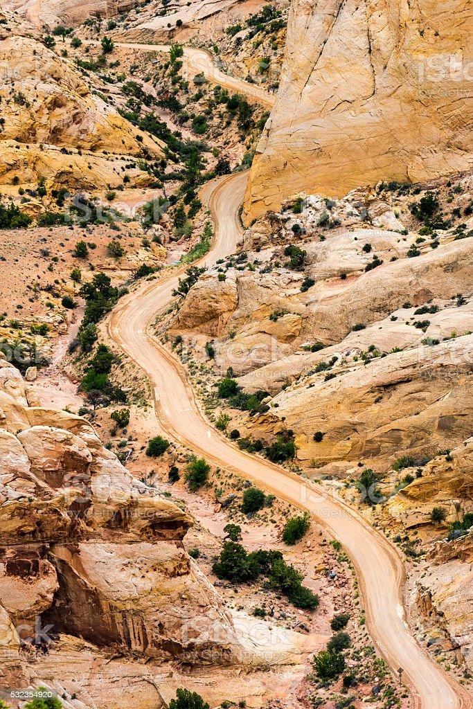 Switchbacks of gravel road in southern Utah stock photo