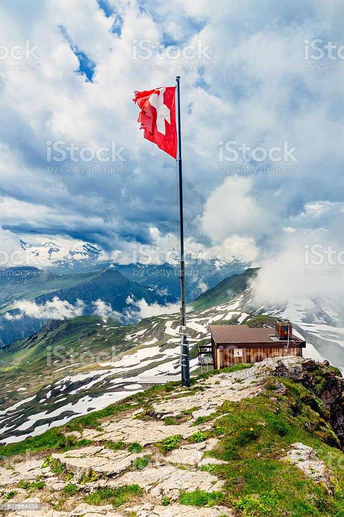Switzerland flag on summit of Faulhorn, Bernese alps stock photo