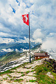Switzerland flag on summit of Faulhorn, Bernese alps