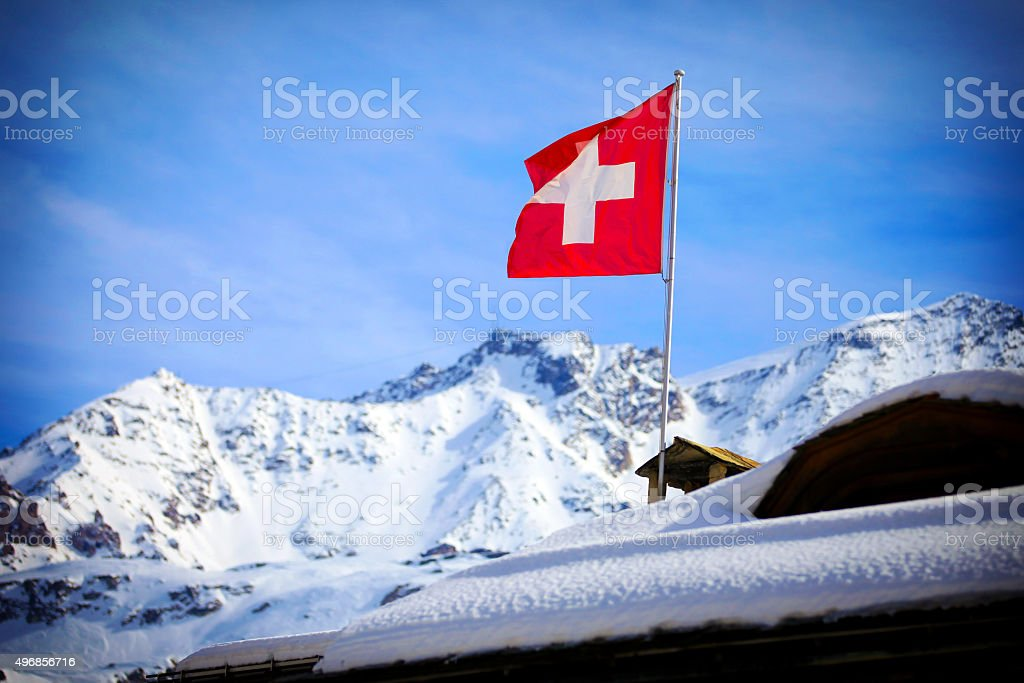 Switzerland flag Over Swiss Mountains stock photo