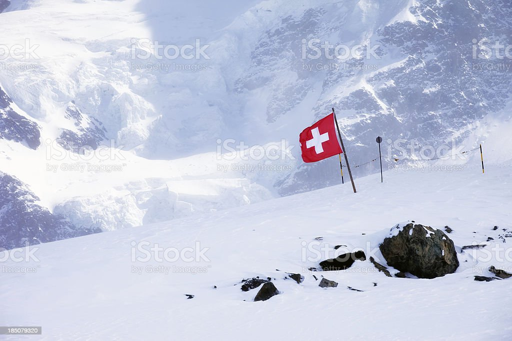 Switzerland flagg in swiss alps stock photo