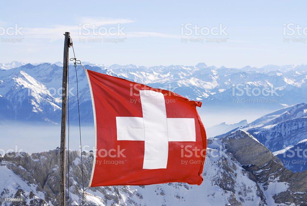 switzerland flagg over swiss alps stock photo