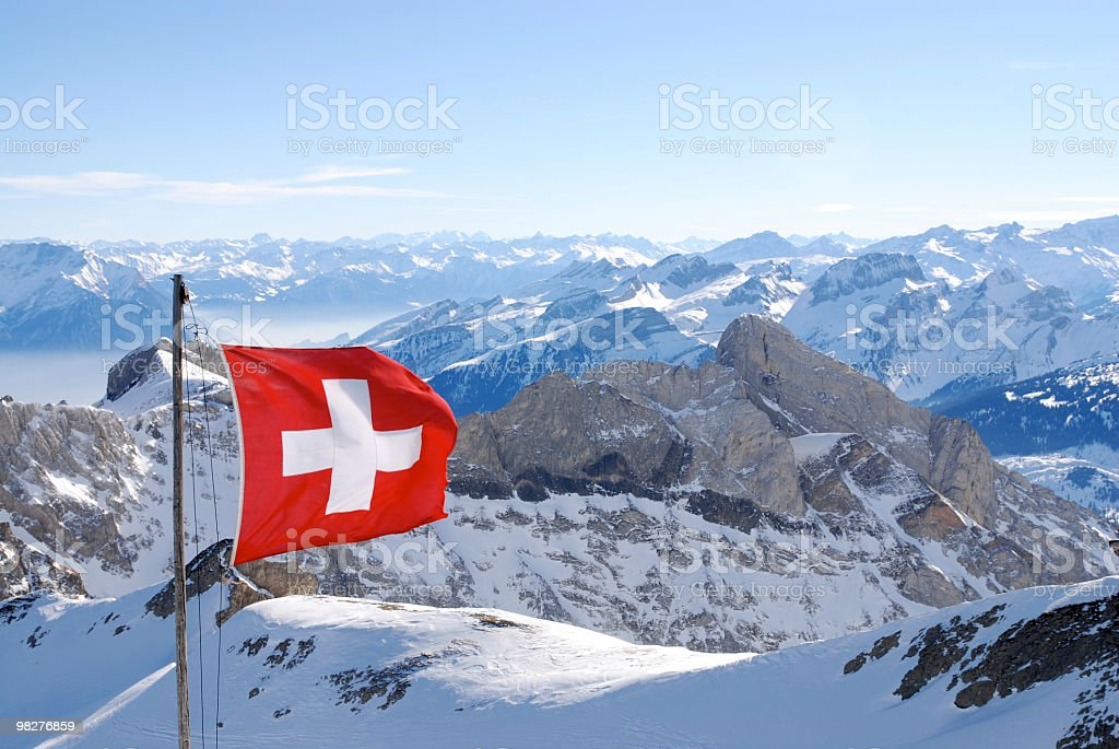 switzerland flagg over swiss alps stock photo