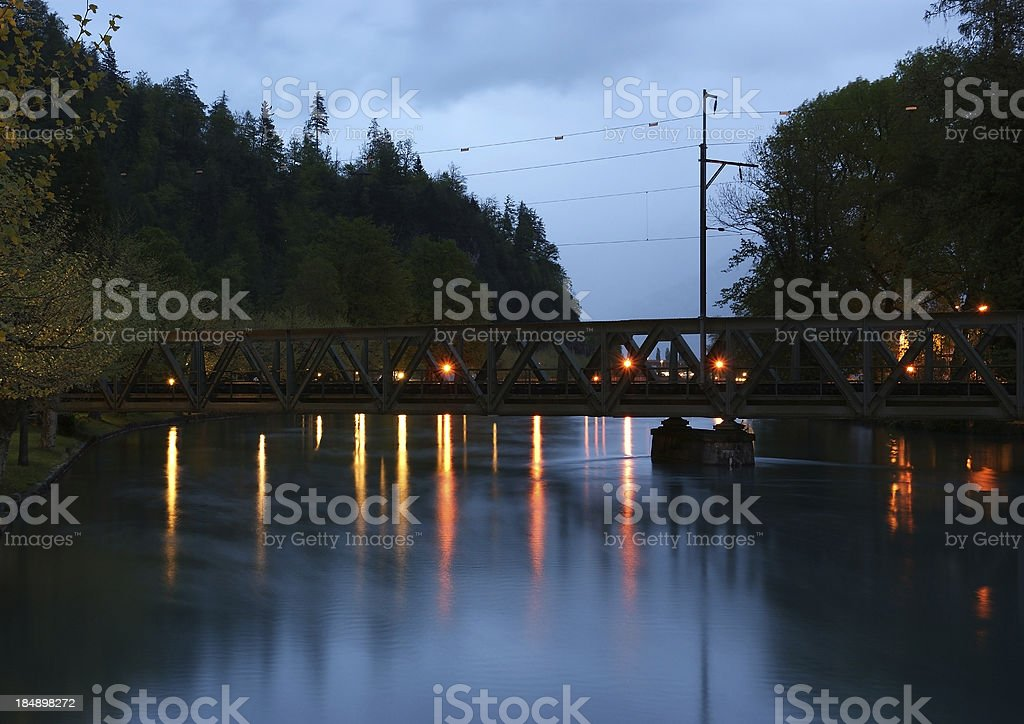 Switzerland, Interlaken. Evening view of a small river and bridge royalty-free stock photo
