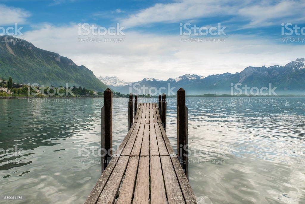 Switzerland landscape - Wooden pier in lake at Switzerland. stock photo