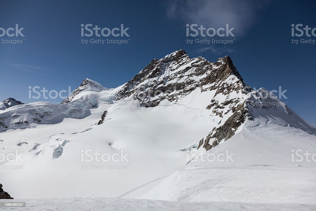 Switzerland mountain covered in snow royalty-free stock photo