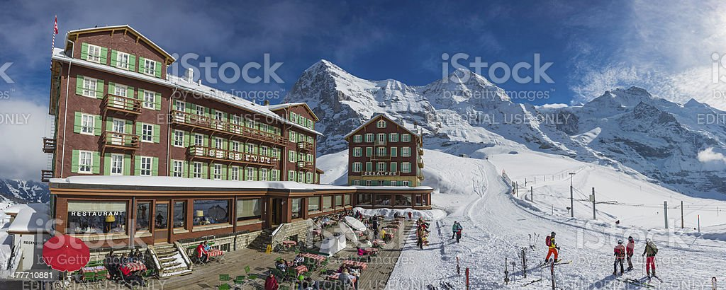 Switzerland skiers enjoying winter sunshine vacation Eiger resort hotel Alps royalty-free stock photo