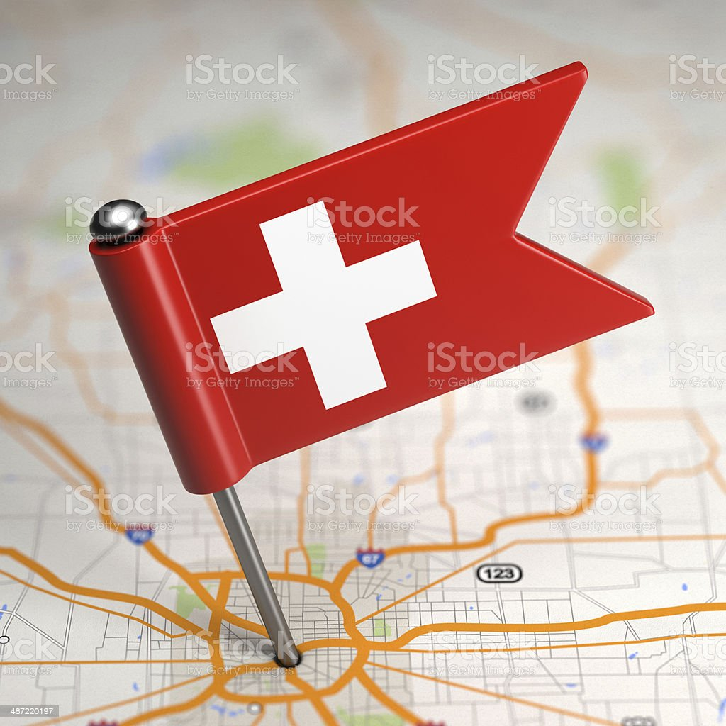 Switzerland Small Flag on a Map Background. stock photo