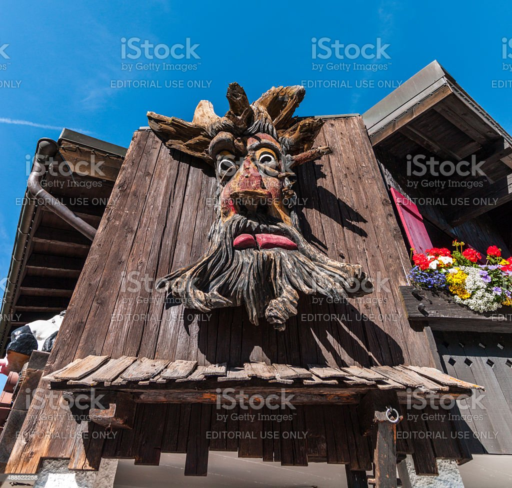 Switzerland. Village of Saas-Fee. Traditional wooden sculpture on a fa?ade. stock photo