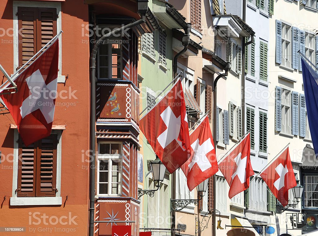 switzerland zurich city with flags on building facade stock photo