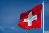 Switzerland's national flag flying