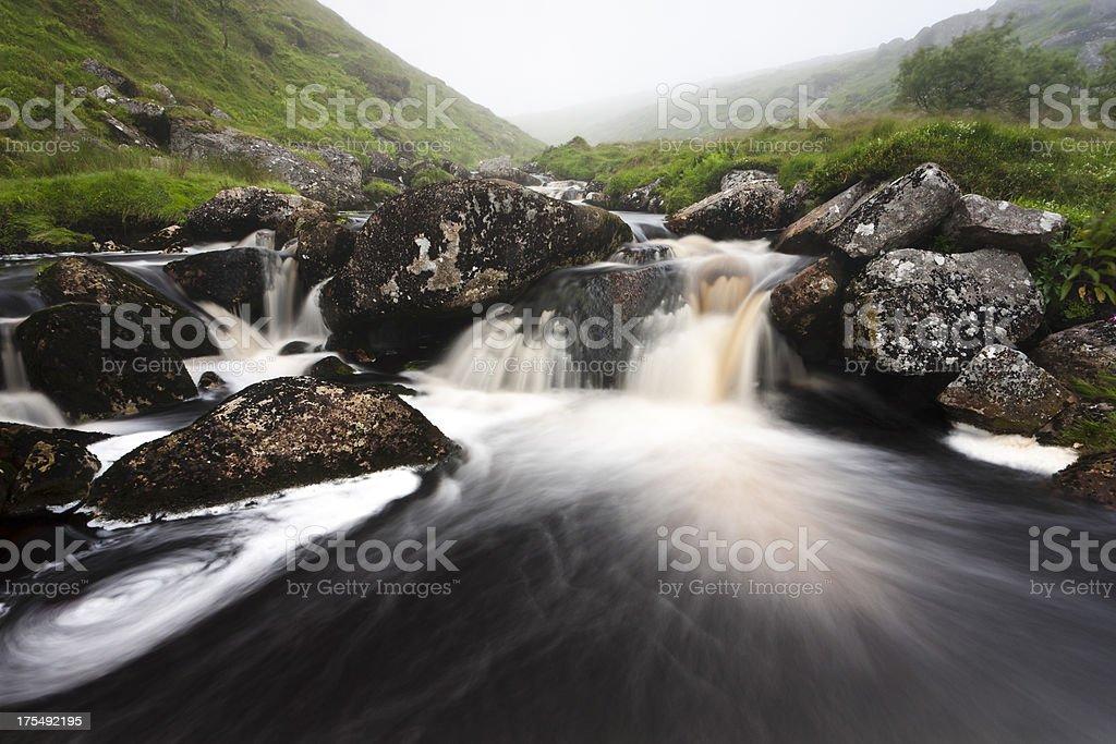 Swollen East Dart river on Dartmoor in cloud stock photo