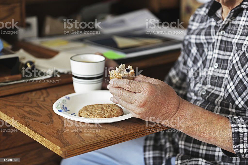Swollen Injured Hand Holding Breakfast Muffin royalty-free stock photo
