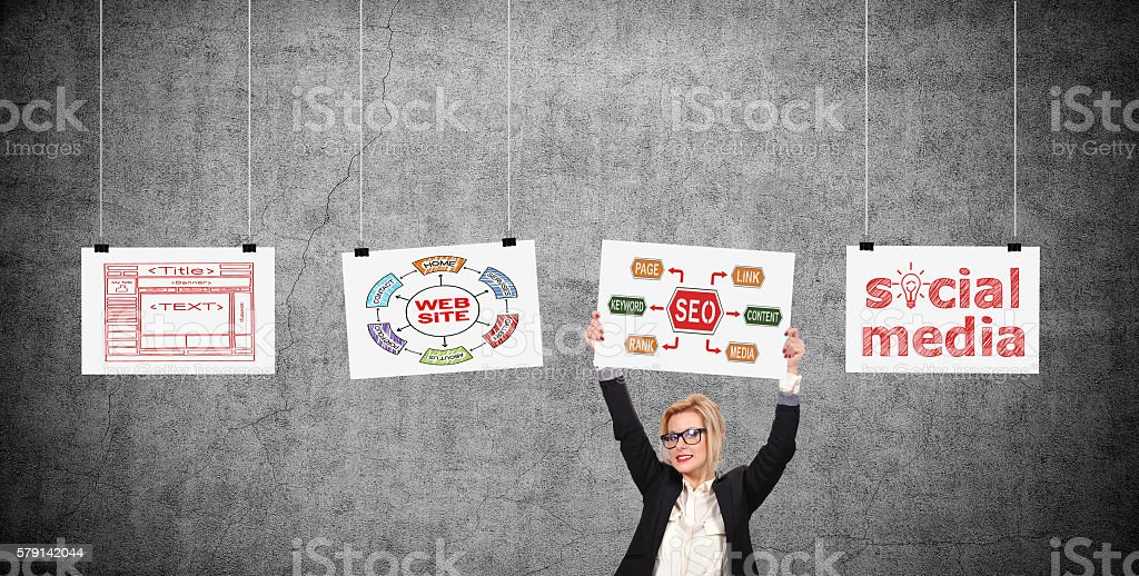 swoman holding placard with seo scheme stock photo