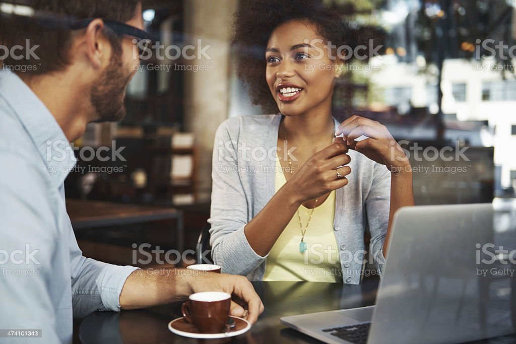 Swopping creative ideas in a relaxed environment stock photo