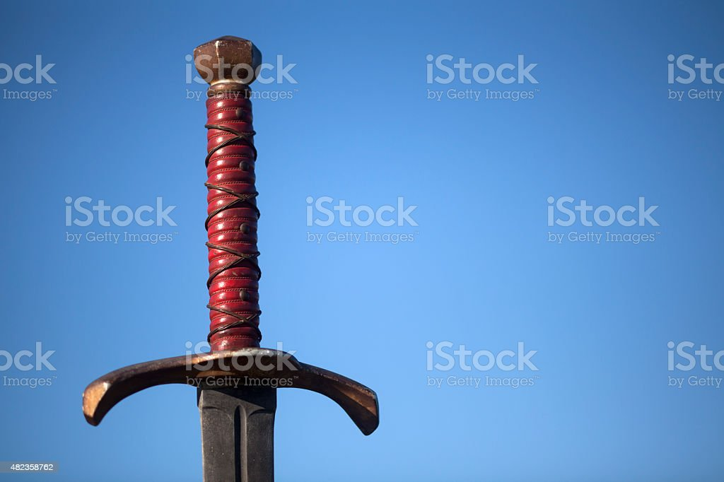 Sword handle with blue sky background stock photo