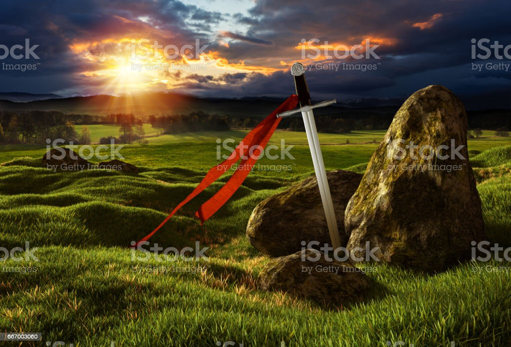 Sword in the dramatic sunny landscape. stock photo