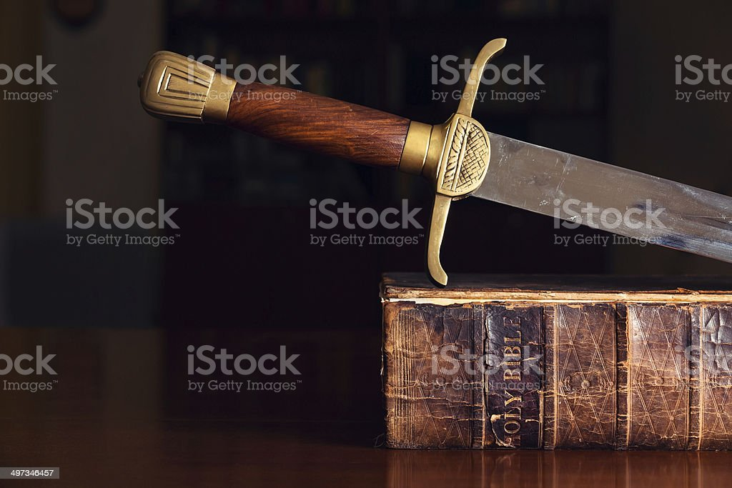 Sword On Old Bible stock photo